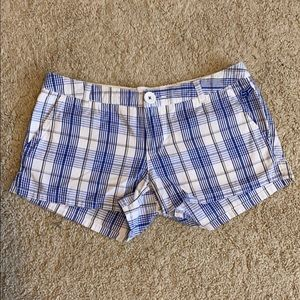 Blue striped shorts.